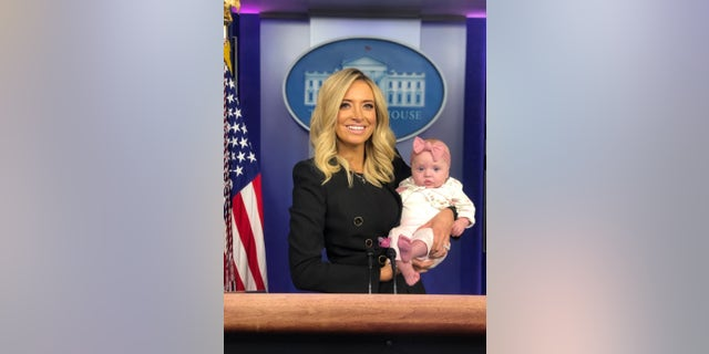McEnany and her daughter, Blake, at the podium in the White House press briefing room after her first briefing on May 1, 2020.