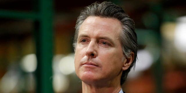 California Gov. Gavin Newsom listens to a reporter's question during a news conference in Rancho Cordova, Calif. on June 26, 2020. (AP Photo/Rich Pedroncelli, Pool, File)