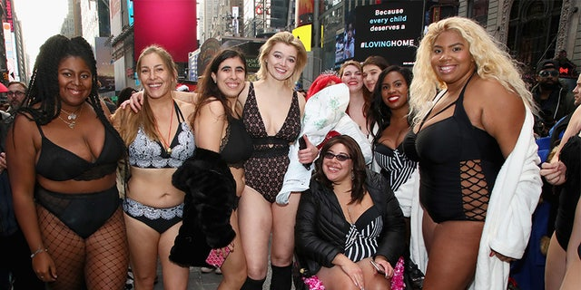 Khrystyana and other models pose for a photo in Times Square for 'The Real Catwalk' on December 1, 2018, in New York City.
