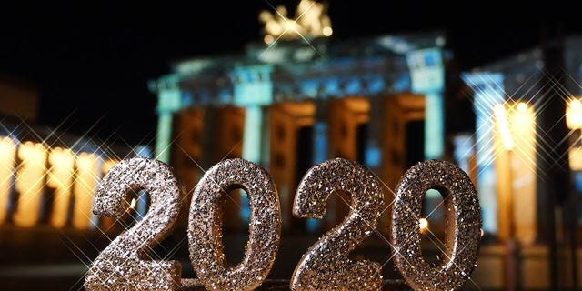 FILE -- Berlin: The number 2020 is in front of the Brandenburg Gate on Pariser Platz in Berlin Mitte. Photo: XAMAX/dpa (Photo by XAMAX/picture alliance via Getty Images)