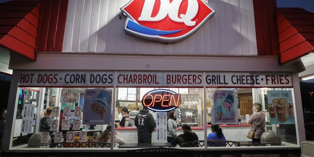 One DQ staff was stunned when a drive-thru customer paid for the vehicle behind him and set off a chain reaction that inspired over 900 others to do the same.