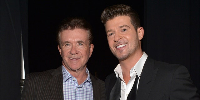 Robin Thicke (right) took to Instagram where he honored his late father Alan Thicke (left).