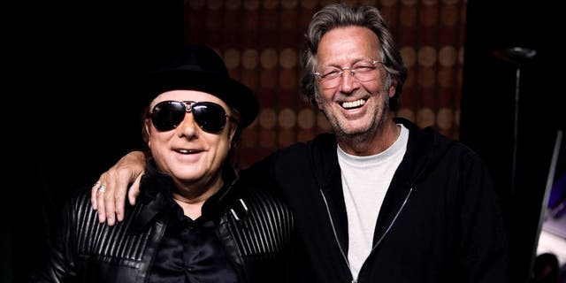 """Eric Clapton and Van Morrison worked on """"Stand and Deliver,"""" a song that is critical about coronavirus lockdowns. (Photo by Listen To The Lion/Lobeline Communcations via Getty Images)"""