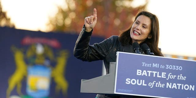 FILE - Gov. Gretchen Whitmer, D-Mich., speaks before Democratic presidential candidate former Vice President Joe Biden and former President Barack Obama speak at a rally at Belle Isle Casino in Detroit, Mich., Saturday, Oct. 31, 2020. (AP Photo/Andrew Harnik)