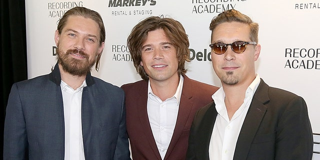Taylor Hanson (center) and his brothers Zac (left) and Isaac (right) are part of the band Hanson. (Photo by Gary Miller/FilmMagic)