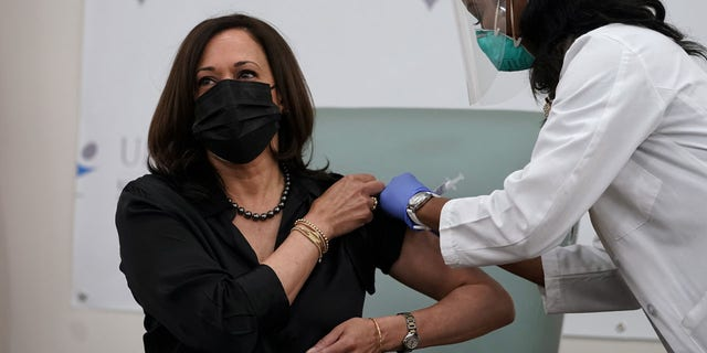 Vice President-elect Kamala Harris receives the Moderna COVID-19 vaccine from nurse Patricia Cummings, Tuesday Dec. 29, 2020, at United Medical Center in southeast Washington. (AP Photo/Jacquelyn Martin)