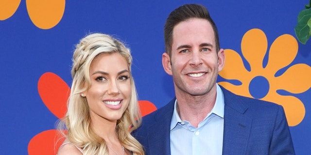 Heather Rae Young (left) previously showed off a new tattoo that she got in honor of her fiancé, Tarek El Moussa (right), which reads, 'Yes sir, Mr. El Moussa.' (Photo by Rachel Luna/Getty Images)