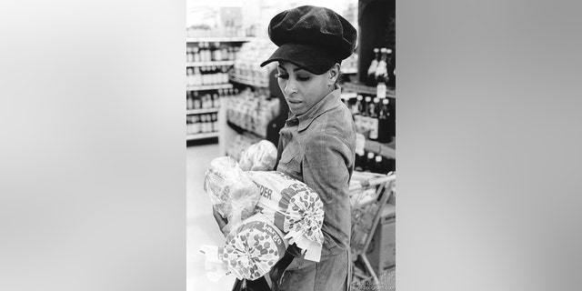 Tina Turner buying bread in a Los Angeles grocery store, circa 1971.