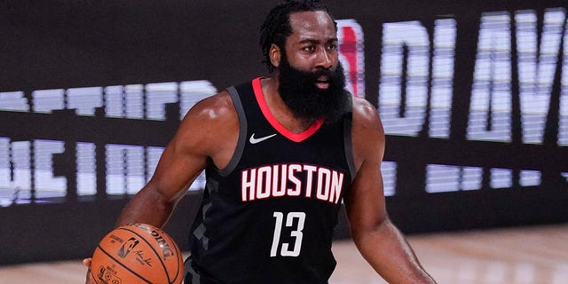 FILE - In this Sept. 12, 2020, file photo, Houston Rockets' James Harden (13) argues a call during the first half of an NBA conference semifinal playoff basketball game against the Los Angeles Lakers in Lake Buena Vista, Fla. (AP Photo)