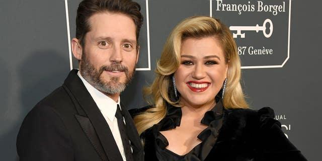 Kelly Clarkson (right) filed for divorce from Brandon Blackstock (left) in June.