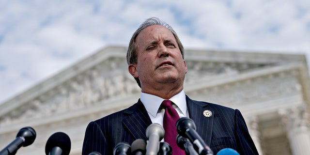 Ken Paxton, Texas attorney general, speaks during a news conference outside the Supreme Court in Washington, D.C., U.S., on Monday, Sept. 9, 2019. Paxton is leading his state's case which essentially seeks to nullify the presidential elections in Georgia, Michigan, Wisconsin and Pennsylvania. Photographer: Andrew Harrer/Bloomberg via Getty Images