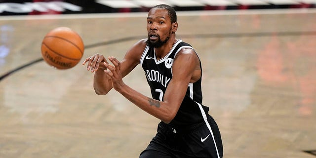Brooklyn Nets forward Kevin Durant passes during the first half of a preseason NBA basketball game against the Washington Wizards, Sunday, Dec. 13, 2020, in New York. (AP Photo/Kathy Willens)