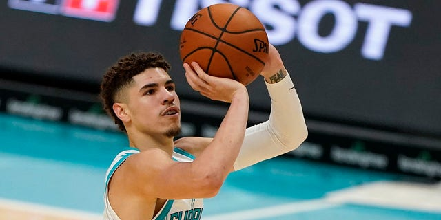 Charlotte Hornets guard LaMelo Ball shoots against the Toronto Raptors during the second half of an NBA preseason basketball game in Charlotte, N.C., on Saturday, Dec. 12, 2020. (AP Photo/Chris Carlson)