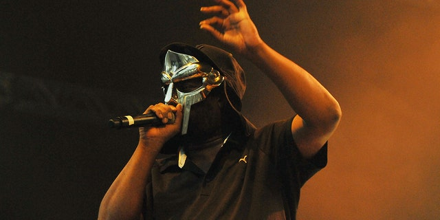 Rapper and forme KMD member MF DOOM was known for performing in a silver mask. (Photo by Jim Dyson/Redferns)
