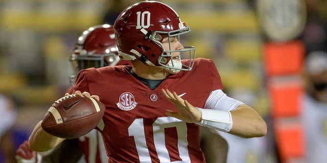 Alabama quarterback Mac Jones (10) throws during the first half of an NCAA college football game against LSU in Baton Rouge, La., Saturday, Dec. 5, 2020. (AP Photo/Matthew Hinton)