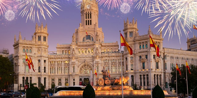 Fountain of the Cibeles and Palace of Communication, Culture and Citizenship Centre in the Cibeles Square of Madrid with fireworks