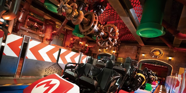 Guests can travel through iconic Mario Kart courses with the interactive roller coaster.