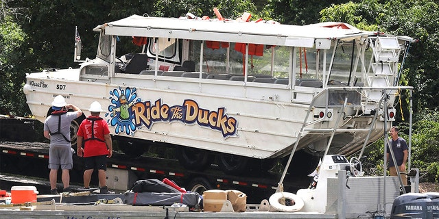 The duck boat is hauled out of the water on July 23, 2018, at Table Rock Lake in Branson, Mo. A federal judge dismissed charges against three people connected to the incident. (J.B. Forbes/St. Louis Post-Dispatch/Tribune News Service via Getty Images)