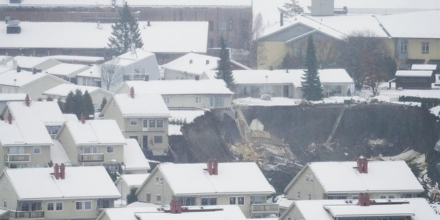 A massive landslide struck the small Norwegian town of Ask Wednesday morning around 4 a.m., leaving 10 people injured and nearly two dozen unaccounted for. (Fredrik Hagen/NTB via AP)