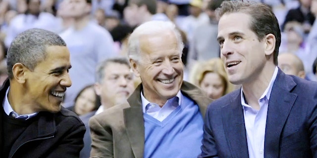 President-elect Joe Biden with his son, Hunter, at a college basketball game in Washington in 2010. The U.S. Attorney's Office in Delaware is investigating the younger Biden's taxes. (AP Photo/Nick Wass, File)