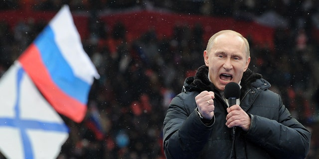 """Russian Presidential candidate, Prime Minister Vladimir Putin delivers a speech during a rally of his supporters at the Luzhniki stadium in Moscow on February 23, 2012. Prime Minister Vladimir Putin on Thursday vowed he would not allow foreign powers to interfere in Russia's internal affairs and predicted victory in an ongoing battle for its future. """"We will not allow anyone interfere in our internal affairs,"""" Putin said in a speech to more than 100,000 people packed into the stadium and its grounds at Moscow's Luzhniki stadium ahead of March 4 presidential elections. . AFP PHOTO/AFP PHOTO / YURI KADOBNOV (Photo credit should read YURI KADOBNOV/AFP via Getty Images)"""