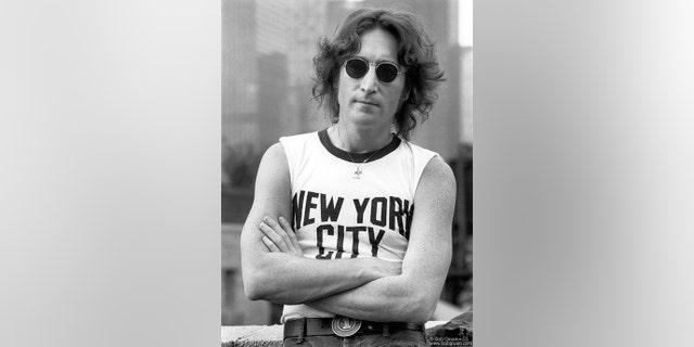 John Lennon on a rooftop in New York City. This image was taken by Bob Gruen on August 29, 1974.