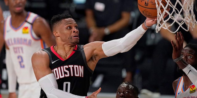 In this Wednesday, Sept. 2, 2020 file photo, the Houston Rockets' Russell Westbrook (0) goes up for a shot as the Oklahoma City Thunder's Nerlens Noel, right, defends during the second half of an NBA first-round playoff basketball game in Lake Buena Vista, Fla. (AP Photo/Mark J. Terrill, File)