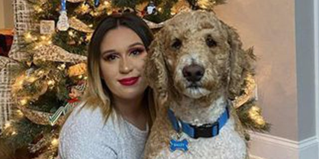 Sarah Simental poses for a Christmas photo with her dog.