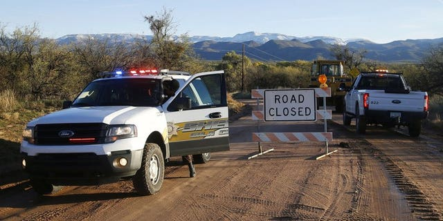 The road closed near Bar X road and Tonto Creek after a vehicle was washed by flood waters in Tonto Basin, Ariz. (Patrick Breen/The Arizona Republic via AP,File)