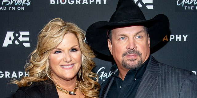 Country star Trisha Yearwood (left) tested positive for the coronavirus, while her husband Garth Brooks (right) tested negative.  (Photo from Roy Rochlin/WireImage)