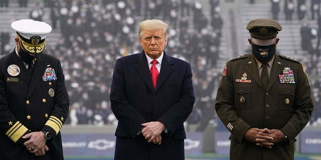 President Donald Trump stands on the field before the 121st Army-Navy Football Game in Michie Stadium at the United States Military Academy, Dec. 12, in West Point, N.Y. (AP Photo/Andrew Harnik)