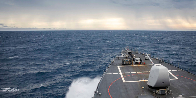 The USS John S. McCain transits through the South China Sea while conducting routine underway operations.