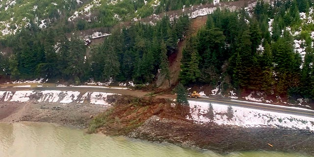 Authorities have identified the two people missing after a landslide the width of two football fields slammed into the southeast Alaska community. (Lt. Erick Oredson/U.S. Coast Guard via AP)