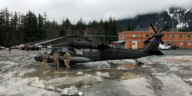 An Alaska Army National Guard UH-60 Black Hawk helicopter has assisted with search and rescue after the landslide. (Alaska Army National Guard via AP)