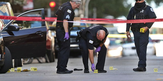 Chicago police investigate the scene of a shooting that killed rapper Carlton Weekly, known as FBG Duck, and wounded two others at 70 E. Oak St. in Chicago on August 4, 2020. (Chris Sweda/Chicago Tribune/Tribune News Service via Getty Images)