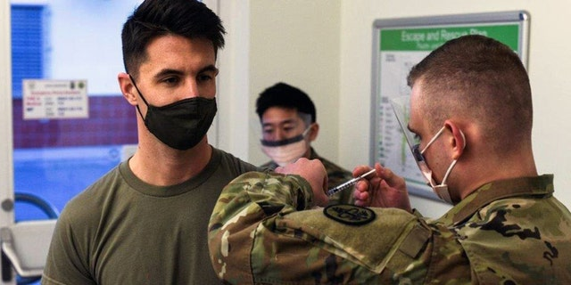 U.S. Army Capt. Skyler Brown, family medicine physician assigned to 1st Squadron, 91st Calvary Regiment (Airborne), 173rd Airborne Brigade Combat Team, is first in all U.S. Army Europe and Africa to receive the coronavirus vaccine. (U.S. European Command Public Affairs)