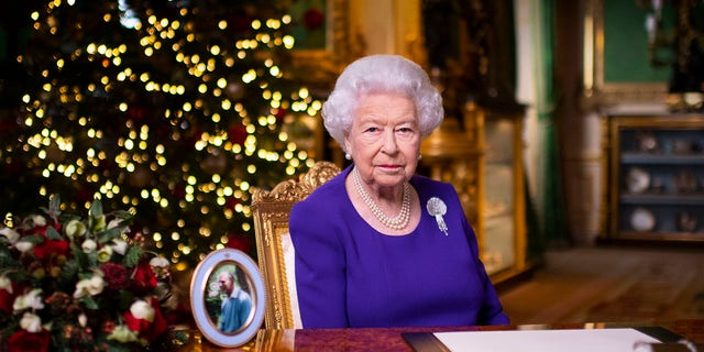 In this undated photo released on Friday, December 25, 2020, Queen Elizabeth II of England recorded her annual Christmas broadcast at Windsor Castle in Windsor, England.  (Associated Press)