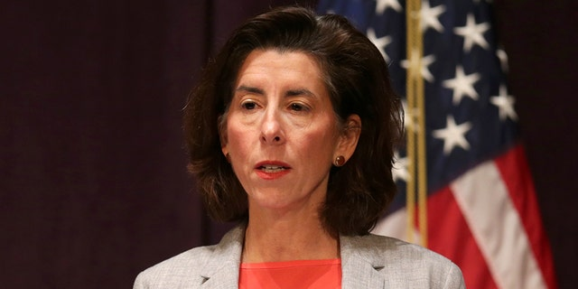 Rhode Island Gov. Gina M. Raimondo speaks at an afternoon press conference at the Vets Memorial Auditorium, in Providence, R.I., on Dec. 3, 2020. (Jonathan Wiggs/The Boston Globe via Getty Images)