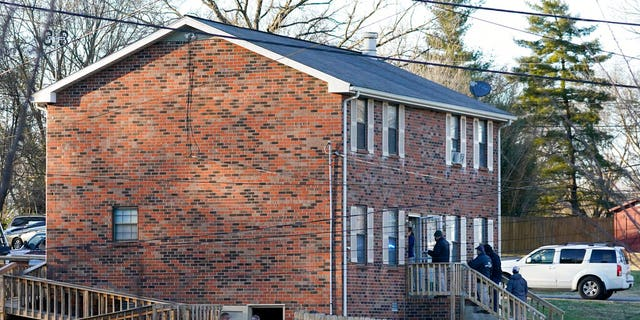 FBI and ATF agents search a home Dec. 26, 2020, in Nashville, Tenn. An explosion that shook the largely deserted streets of downtown Nashville early Christmas morning shattered windows, damaged buildings, and wounded three people. Authorities said they believed the blast was intentional.