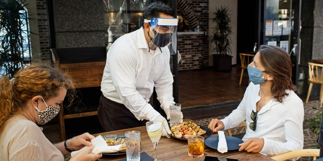 Restaurants are turning to empty hotel suites to offer guests safe, private indoor dining experiences during the pandemic and cold weather months. (iStock)