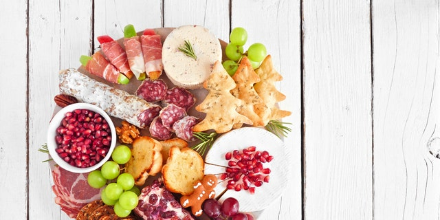 To pull off the newest trend, you'll have to arrange your meats and cheeses in a wreath-like shape.