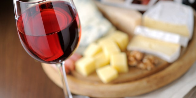 Wine and cheese consumption may help delay cognative decline, new resarch suggests. (iStock).