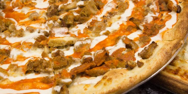 Buffalo chicken pizza offers a protein-based topping with a touch of tangy sauce. (iStock)