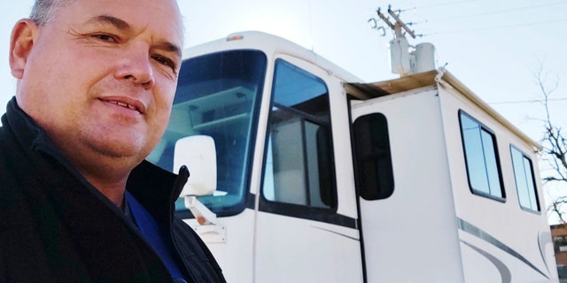 Lewallen, a radiology technician has been sleeping in an RV in the parking lot of his rural Kansas hospital because his co-workers are out sick with COVID-19 and no one else is available to take X-rays.