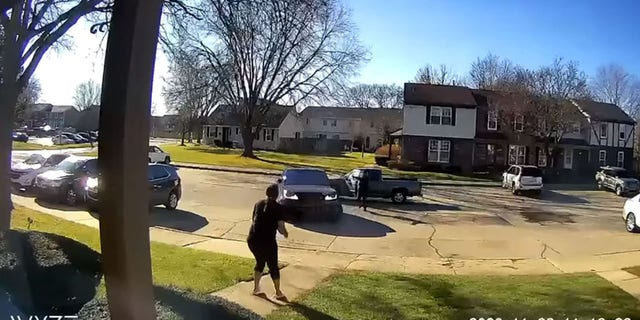 This still image from surveillance footage shows a gunman in a pickup truck drive behind and block the victim from pulling out of a parking spot at a condominium before opening fire in Sterling Heights, Mich., on Saturday.