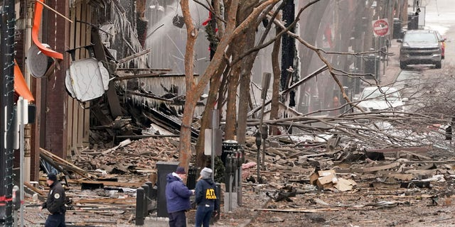 Emergency personnel work near the scene of an explosion in downtown Nashville, Tenn., Dec. 25. (AP Photo/Mark Humphrey)