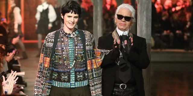 Stella Tennant and Karl Lagerfeld walk the runway at the CHANEL: Metiers d'Art fashion show at Linlithgow Palace on December 4, 2012 in Linlithgow, Scotland.