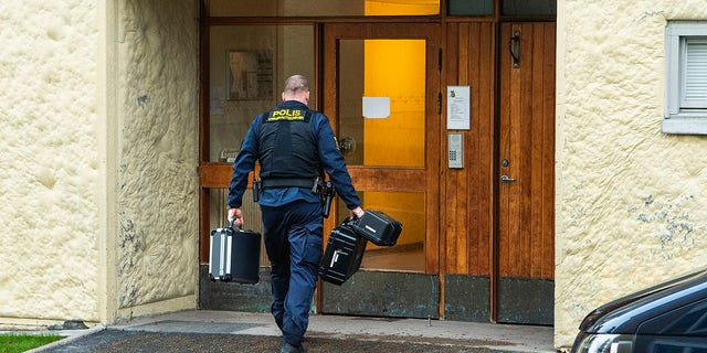 Police at the scene of an apartment where a woman is suspected of locking up her son for 28 years, in Haninge, south of Stockholm. (Claudio Bresciani/TT via AP)