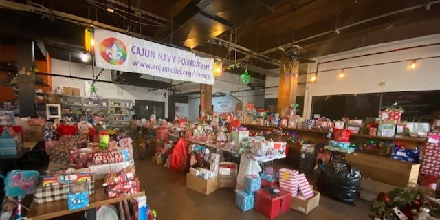 The Cajun Navy Headquarters quickly turns into Santa's workshop as they collect Christmas gifts for kids in need.