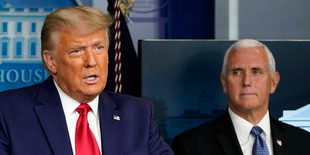 FILE - In this Nov. 24, 2020, file photo President Donald Trump speaks in the press briefing room as Vice President Mike Pence listens in Washington. (Associated Press)